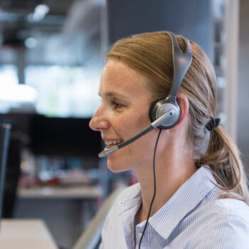 Woman offering help desk support
